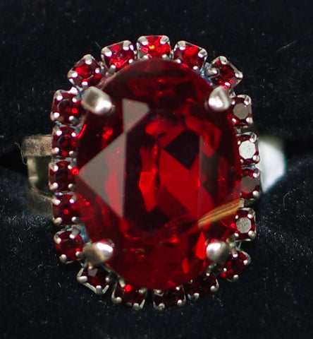"MARIANA RING LADY IN RED: red stones in 7/8"" silver setting, adjustable size band"