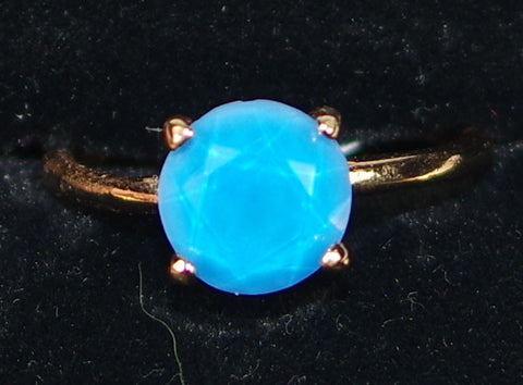 "MARIANA RING BLUE MINERAL: blue mineral stone in 1/4"" rose gold setting, adjustable size band"