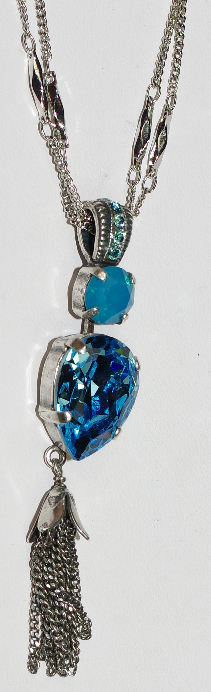 "MARIANA PENDANT ZAMBIZI: blue stones in 2.5"" silver setting, 18"" adjustable double chain"