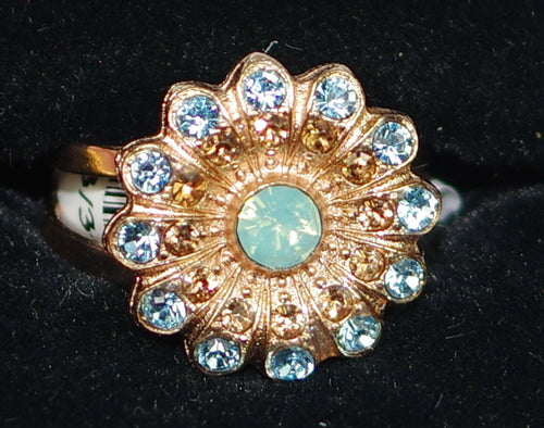 "MARIANA RING FORGET ME NOT DAHLIA: pacific opal, blue stones in 5/8"" rose gold setting, adjustable size band"