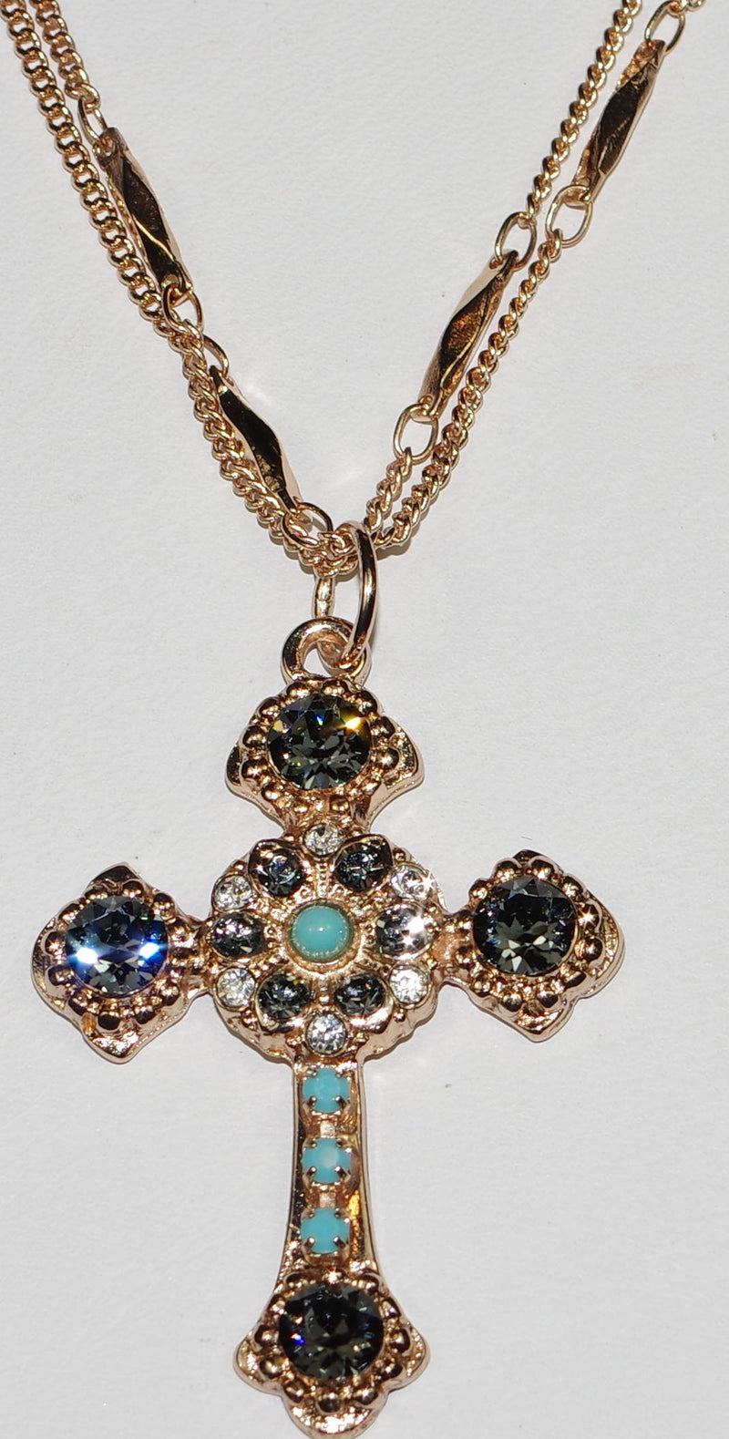 "MARIANA CROSS PENDANT ZANZIBAR: blue, clear stones in rose gold setting, 18"" double chain"