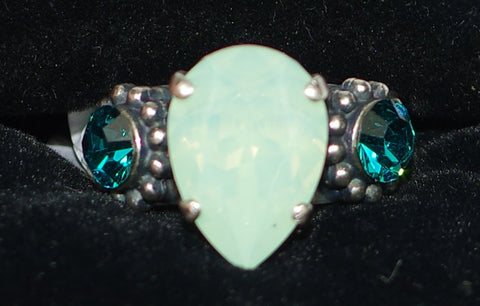 "MARIANA RING CONGO: pacific opal, blue stones, center stone = 1/2"", silver setting, adjustable size band"