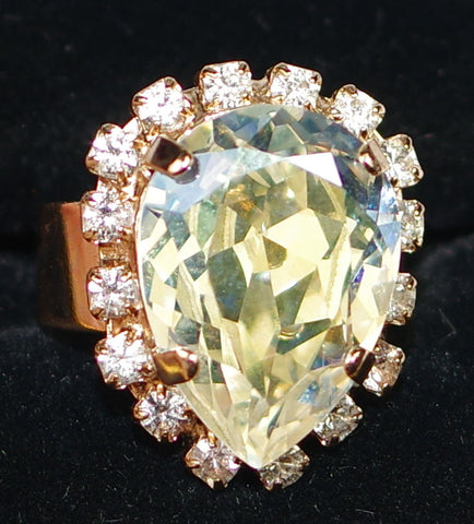 "MARIANA RING KALAHARI: amber, clear stones, center stone = 3/4"" in rose gold setting, adjustable size band"