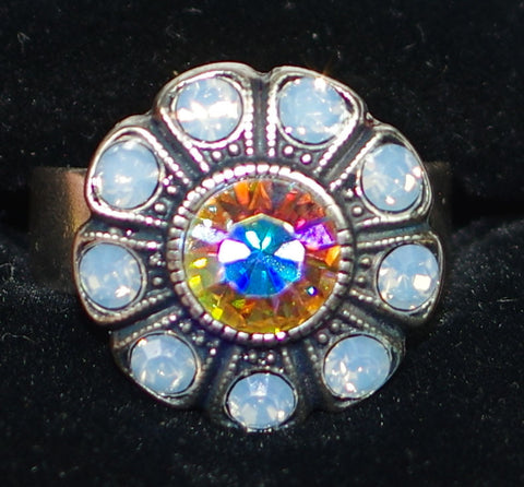 "MARIANA RING COSMO: pink a/b, blue stones in 3/4"" silver setting, adjustable size band"