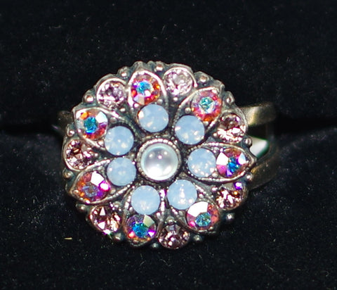 "MARIANA RING COSMO: pink A/B, blue, white stones in 5/8"" silver setting, adjustable size band"