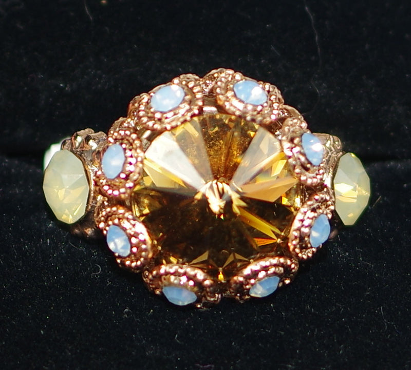"MARIANA RING RHAPSODE XOXO: amber, blue, white stones in 3/4"" rose gold setting, adjustable size band"
