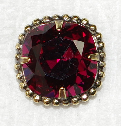 "SORRELLI EARRINGS CUSHION-CUT SOLATAIRE FUSCHIA: 5/8"" post rounded-edge, cushion cut stone in vintage inspired decorative edge border, in antique gold setting"