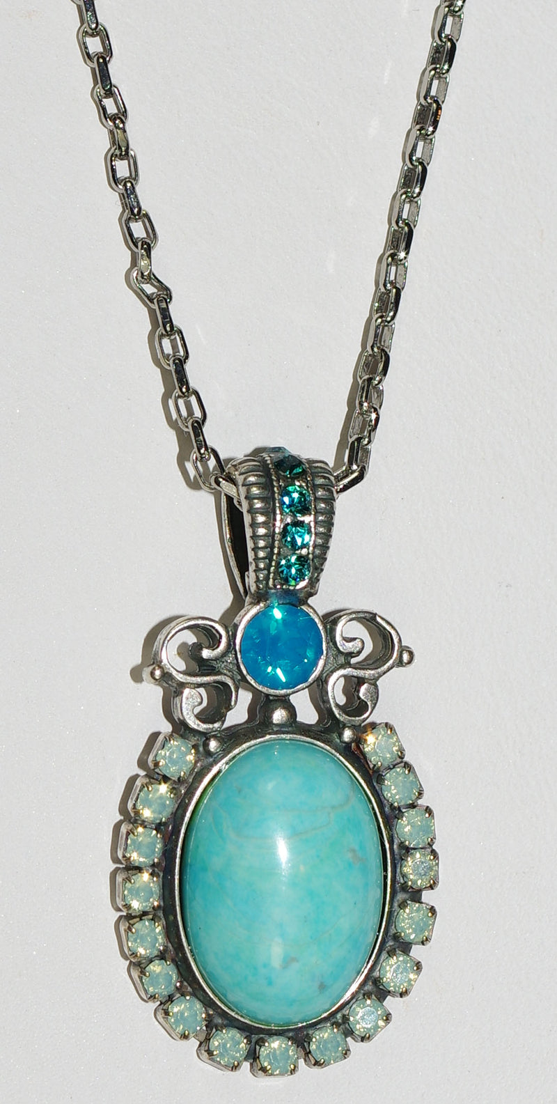 "MARIANA PENDANT BAHAMAS: blue, pacific opal, teal stones in 1.75"" silver setting, 28"" adjustable chain"