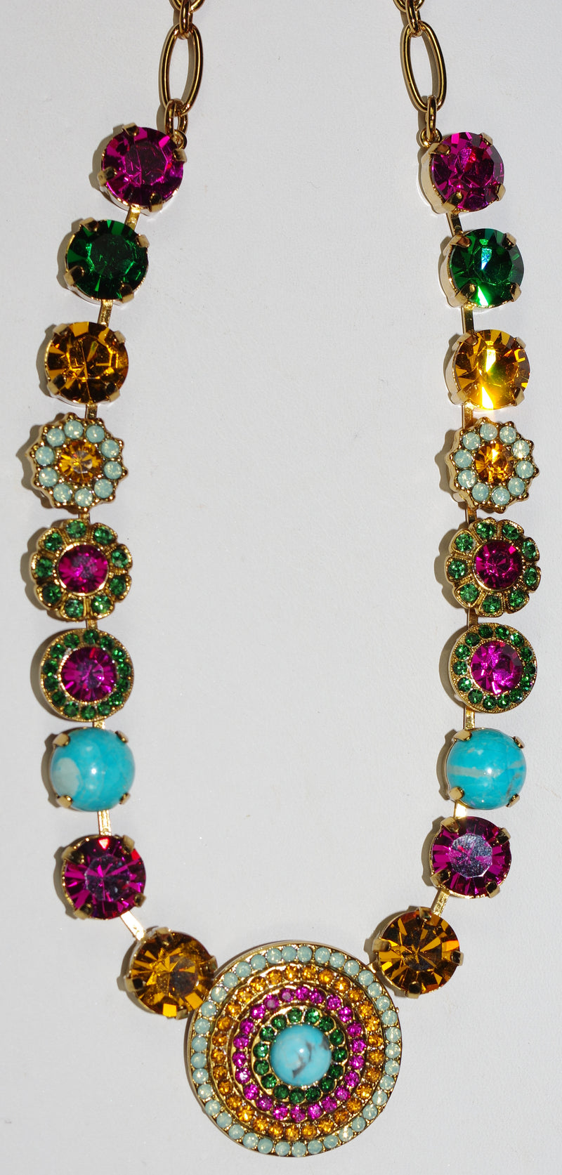 "MARIANA NECKLACE HAPPY DAYS: pink, blue, amber, green stones in european gold setting, center stone 1.25"", 18"" adjustable chain"