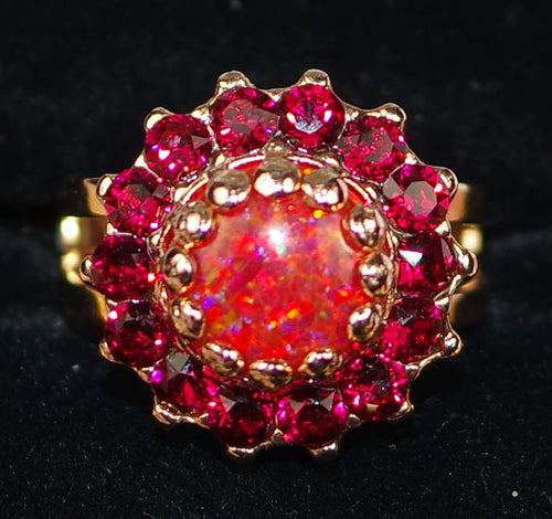 "MARIANA RING FIRE: red, simulated opal stones, 1"" rose gold setting, adjustable band"
