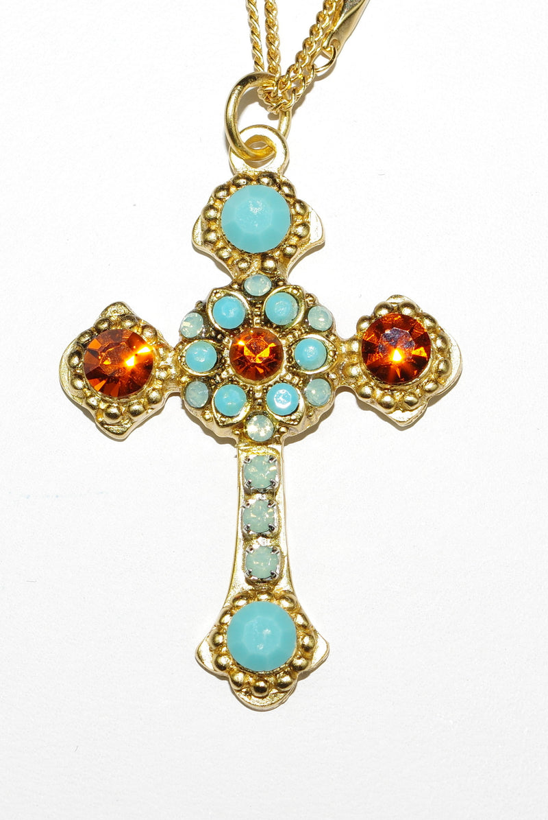 "MARIANA CROSS PENDANT RISING SUN: turq, topaz stones in yellow gold setting, 18"" double chain"