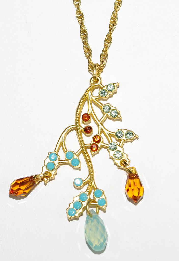 "MARIANA PENDANT RISING SUN: amber, pacific opal, turq stones in 2"" pendant, yellow gold setting, 18"" adjustable chain"