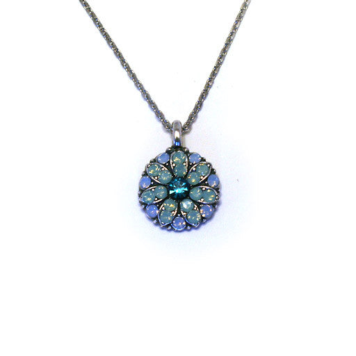 Mariana Angel Pendant: dark teal center, light teal stones in silver setting