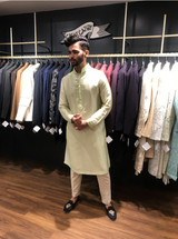 Pista Green Hand Embroidered Kurta paired with a Cream Pintucks Pajama