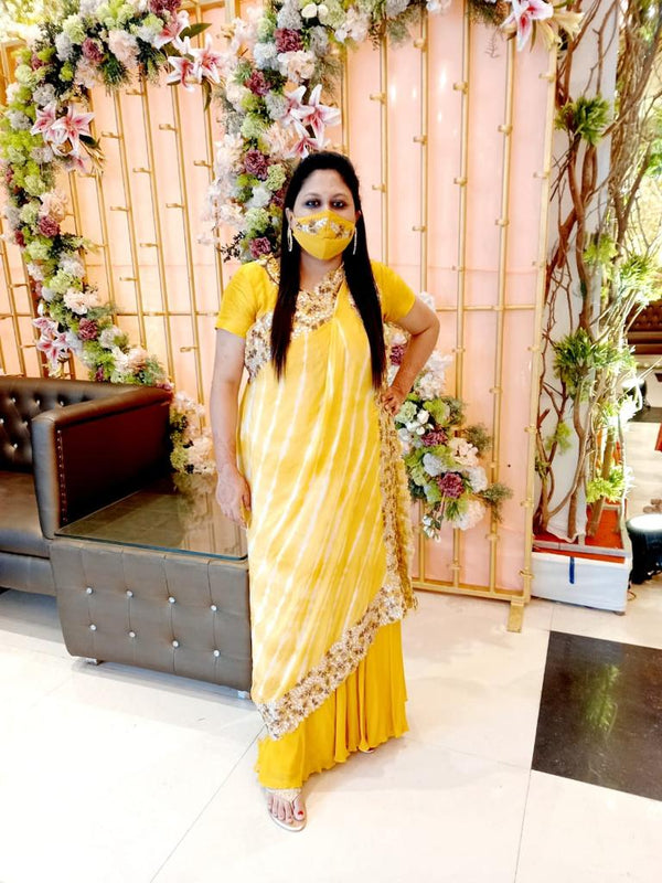 Mustard Yellow Gown with a Lehriya Dupatta