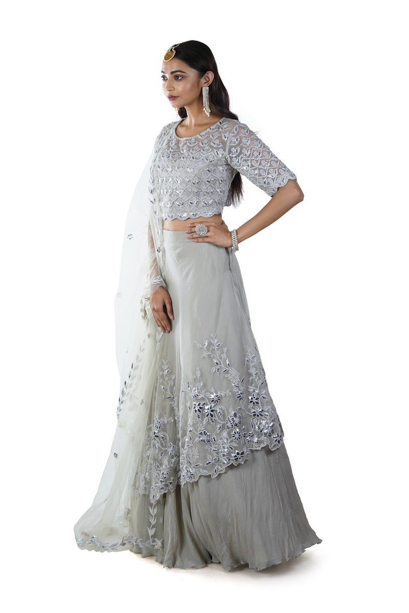 Light Green Floral Embroidered Blouse with an Asymmetrically Layered Lehenga paired with a Dupatta