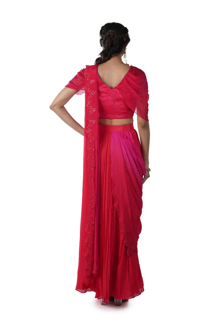 Tomato Red Embroidered Blouse with an attached Palla paired with a Pleated Skirt