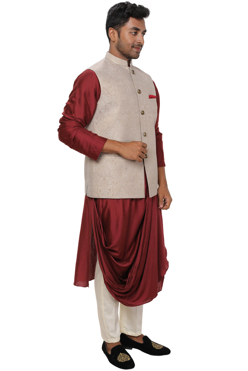 Maroon Cowl Drape Kurta Set paired with an Off White & Gold Self Embroidered Nehru Jacket