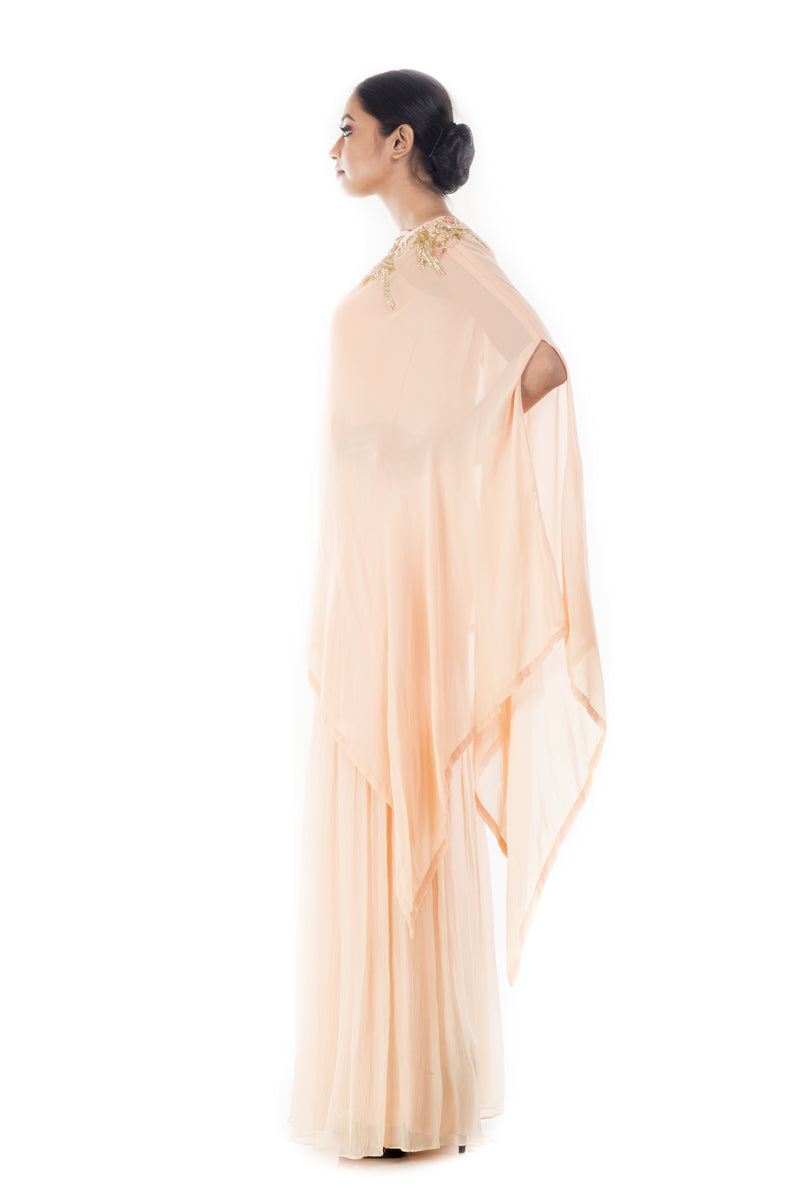 Creamsicle Jumpsuit Paired With A Cape