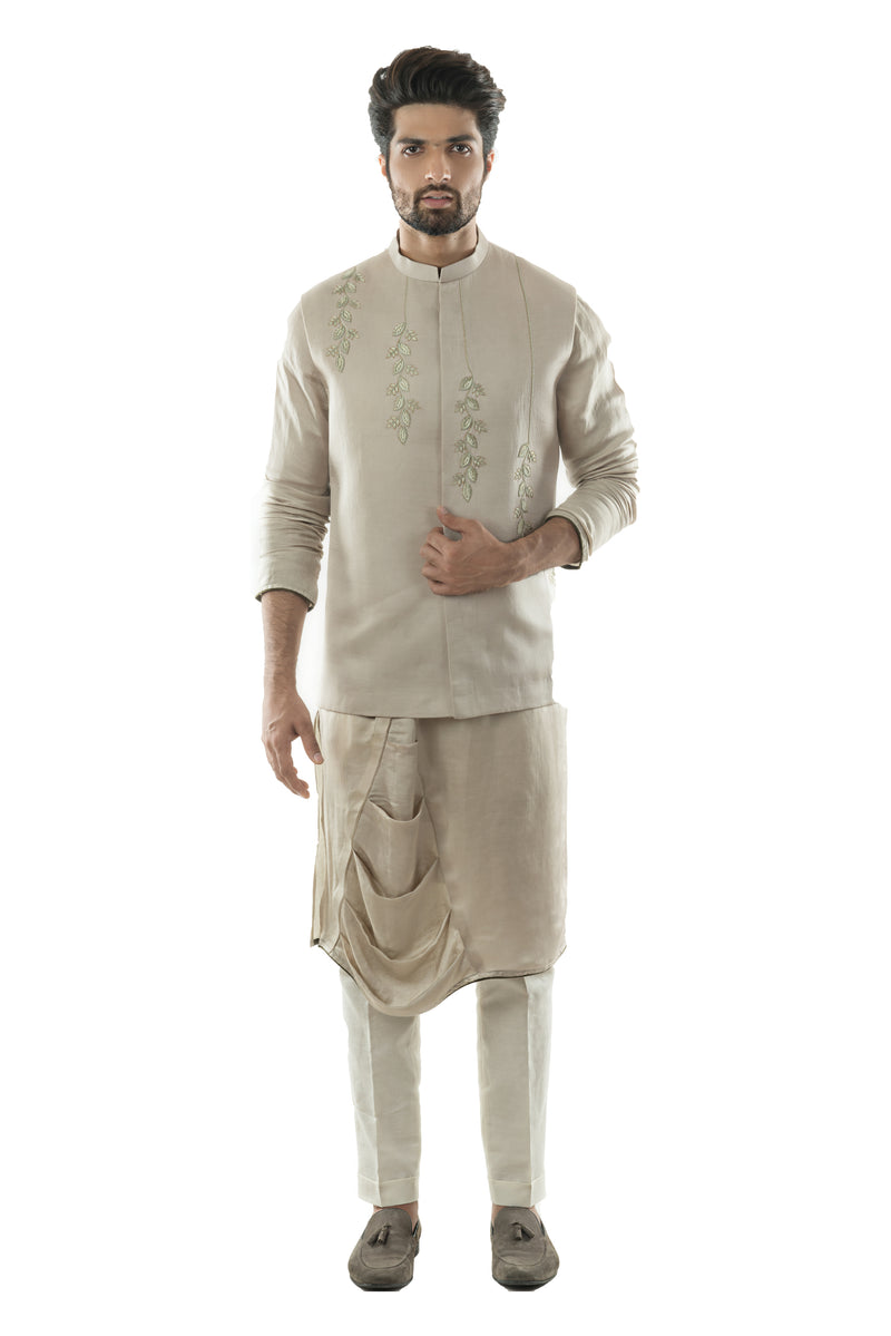 An Oyester Grey Nehru With Minimal Zari And Silk Thread Hand Embroidery. Paired With A Drape Kurta and Narrow Fitted Pant Pajama.