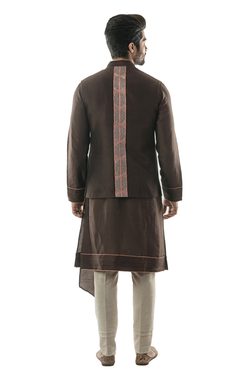 Soil Brown Bandi in Linen Satin with Linear Embroidery in Pastel coloured Silk Threads. Paired with a Soil Brown Kurta with Dupatta Drape and Pintucks Detailing and Cream Pant Style Pajamas.