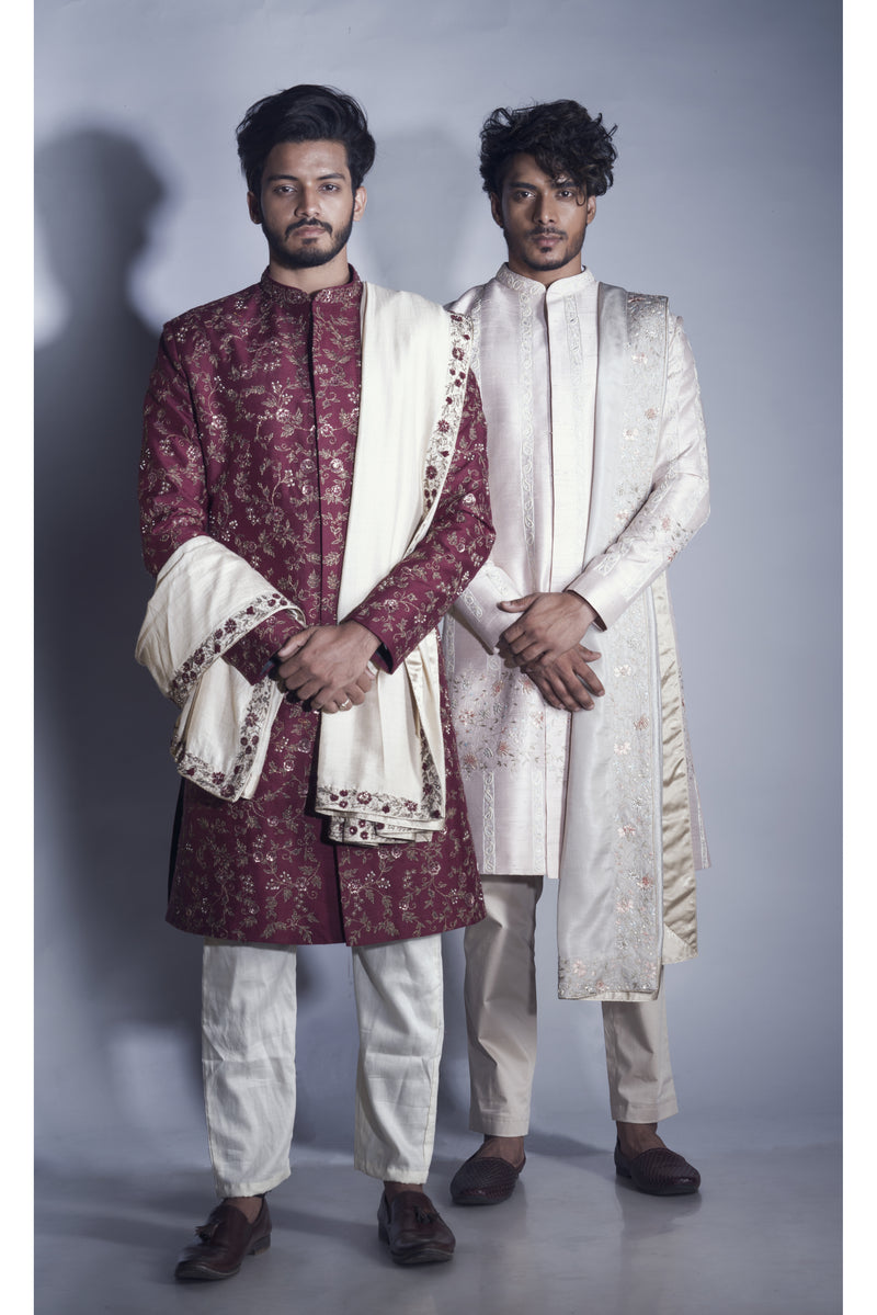 Maroon Sherwani with Jaal Zari work with an Embrodered Silk Dupatta and Churidar