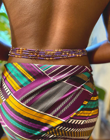 woman standing while wearing waist beads