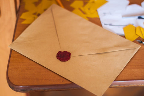 letter on table with wax seal