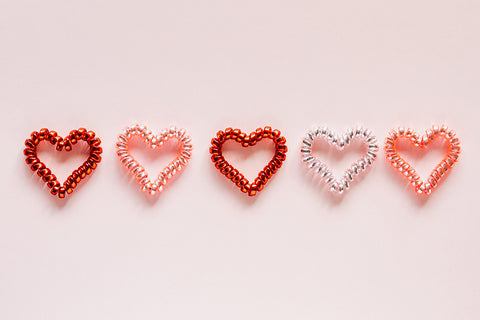 hearts on pink paper for Valentines Day