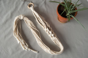 Hand-craft your very own plant hanger in this macrame kit!
