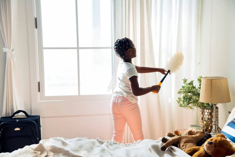 girl-cleaning-curtain