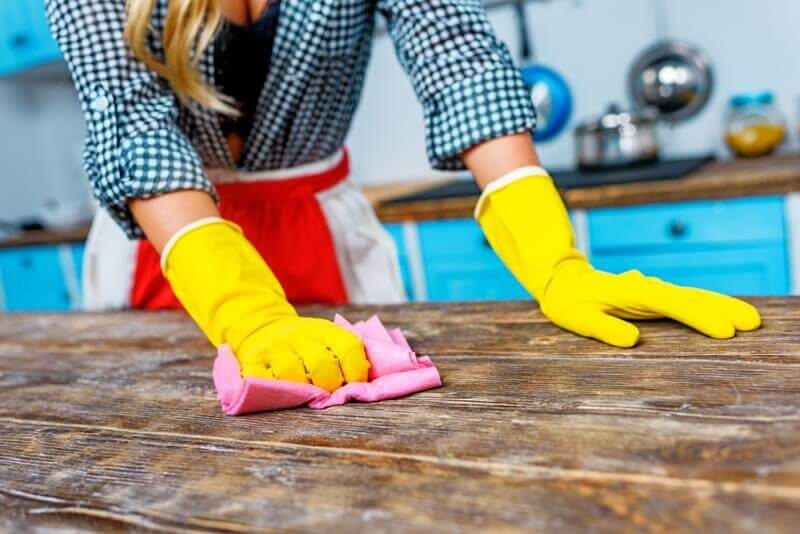 woman-cleaning-counter-table