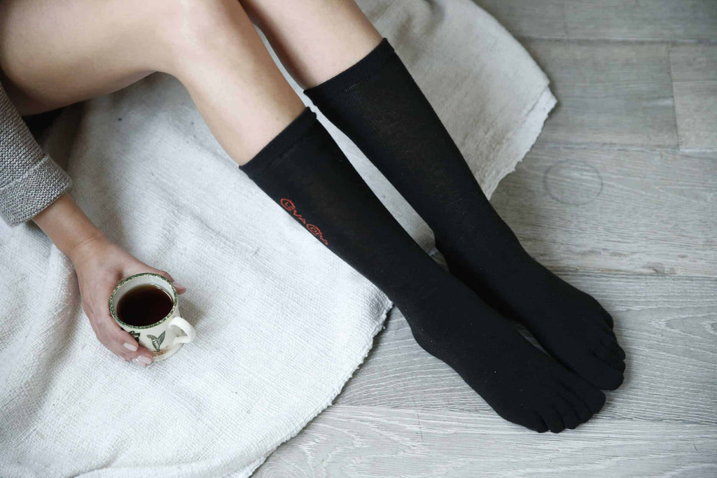 girl sitting with compression socks