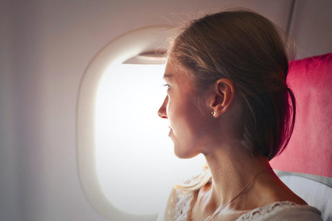 Girl looking out of the flight window