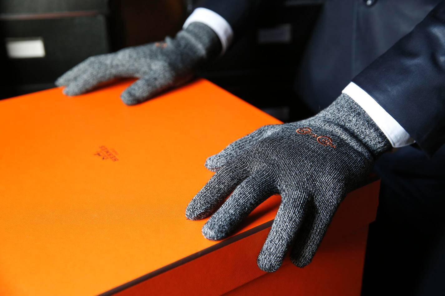 Opening hermes box with copper compression gloves