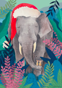 a Fun  jigsaw of an elephant wearing a santa hat.