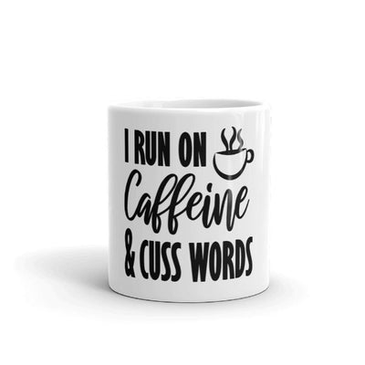"Sarcastic Coffee Mug.  White Ceramic Coffee Mug with the quote ""I run on caffeine and cuss words"".  Fun coffee gifts and coffee bar mugs.  11 oz mug."