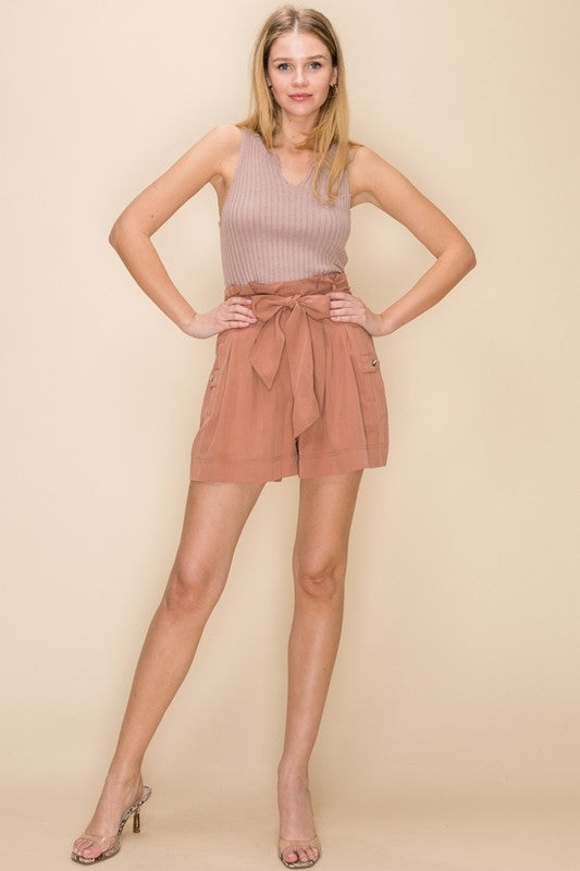 On A High-Waisted Taupe Utility Style Shorts with Tie Belt