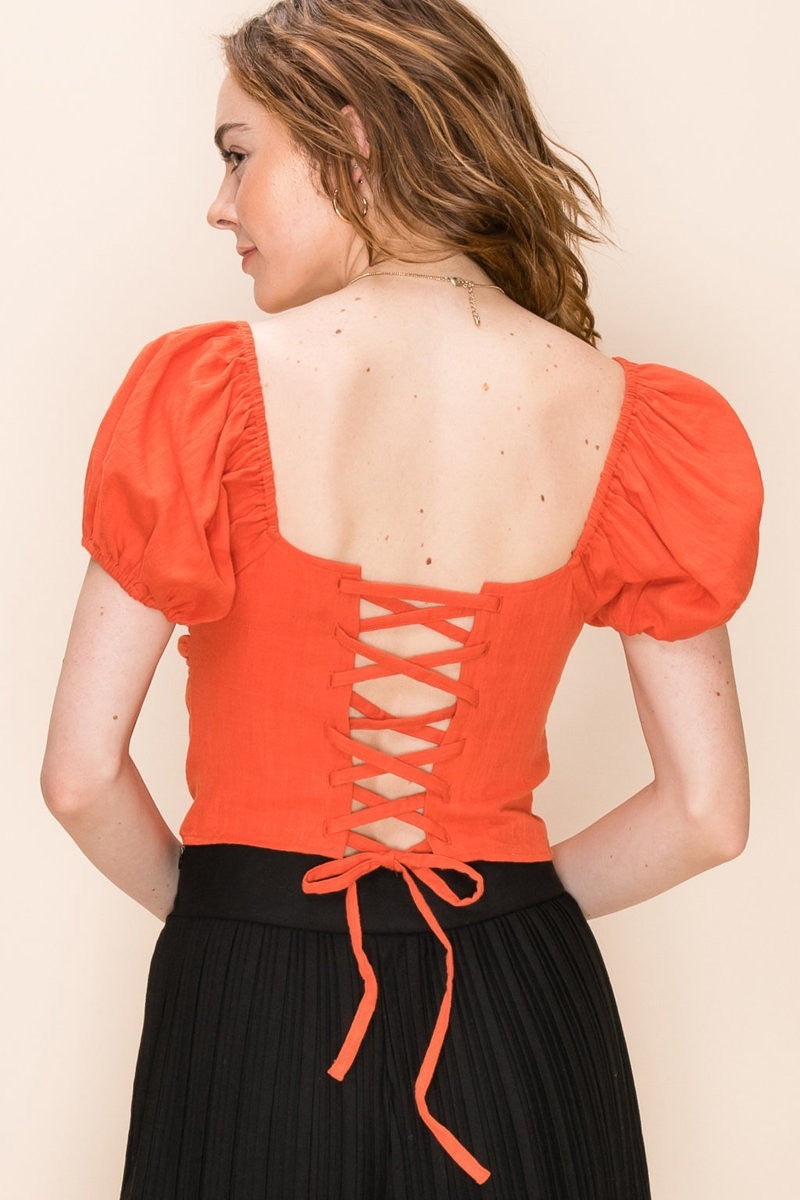 A Lil Tied Up Orange Puff Sleeve Crop Top with Open Tie Back
