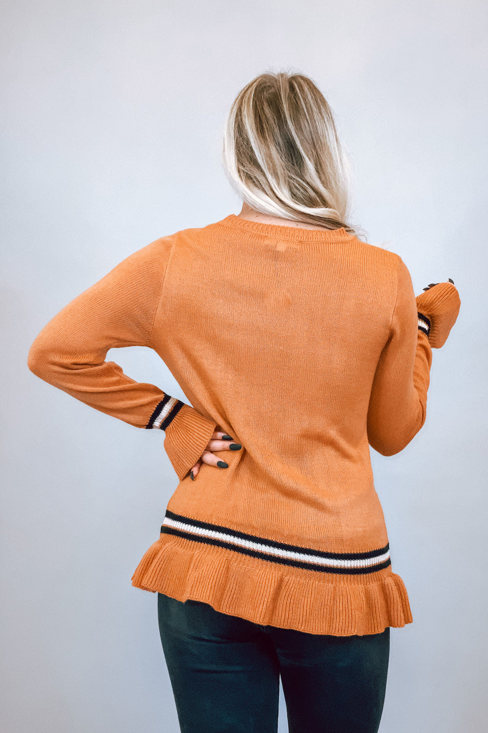 Light Rust Sweater with Contrast Stripes & Ruffle Detailing