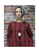 RED & BLACK PLAID DRESS WITH WHITE & BLACK ROUND, DESIGNS BY SONIA NECKLACE