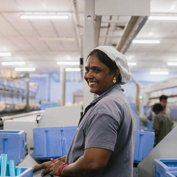 woman smiling while working in factory