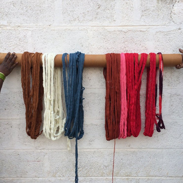 freshly dyed string hanging out to dry in fresh air