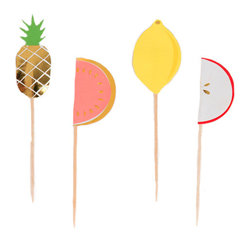 Fruit picks for a tropical birthday party, featuring tropical fruits such as gold pineapples, watermelons, lemons ans apples.