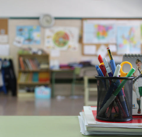 a colorful classroom with a closeup of a desk