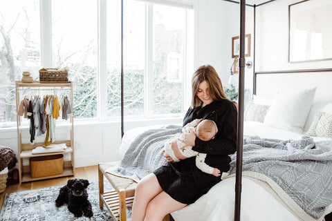 Cristina Toff with her baby on bed