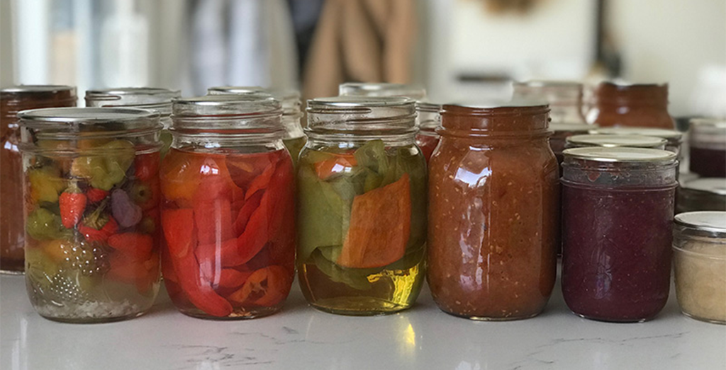 Jars of pickled peppers and jam