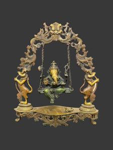 Puja Ganesha on Swing with Bronze Arch