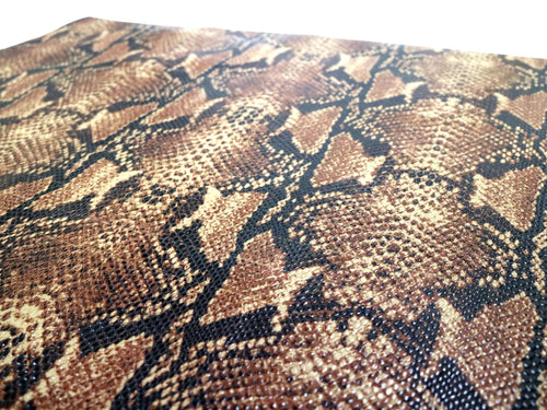 Stonestreet Leather Brown and black python snake print leather sold by the square foot.
