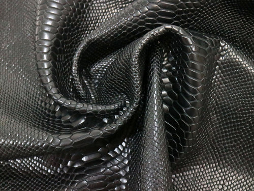 Black twist embossed snake print leather sold by the square foot.